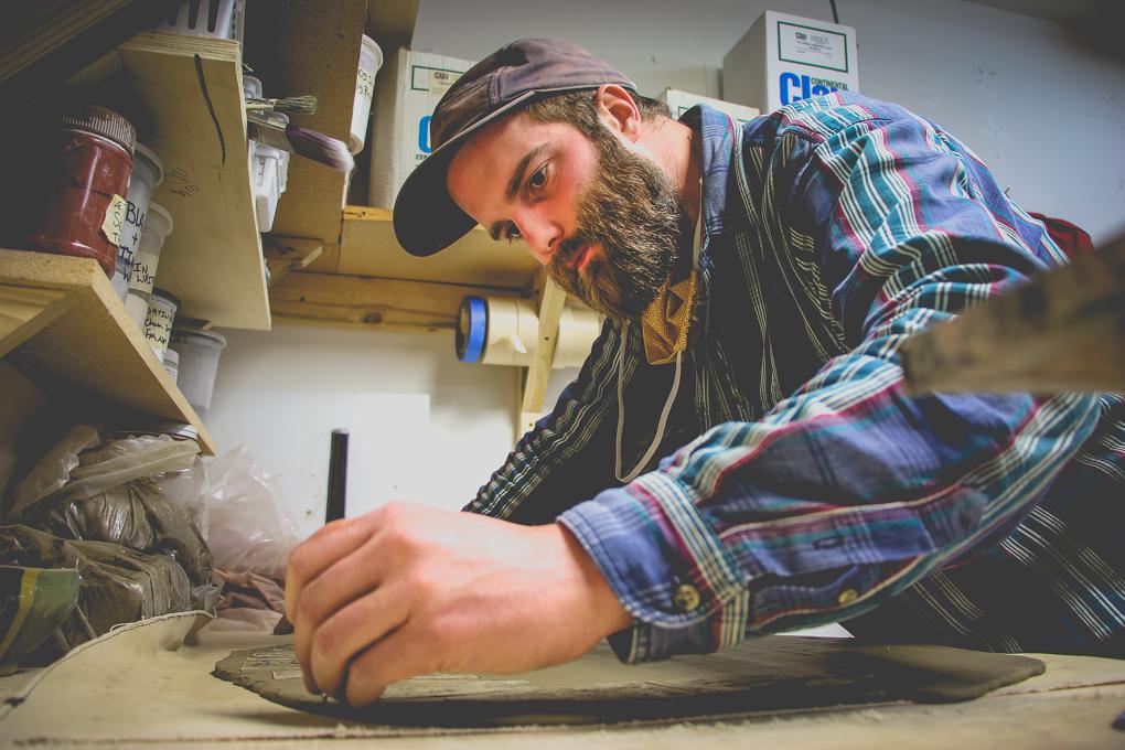 John Scully cuts into clay slab